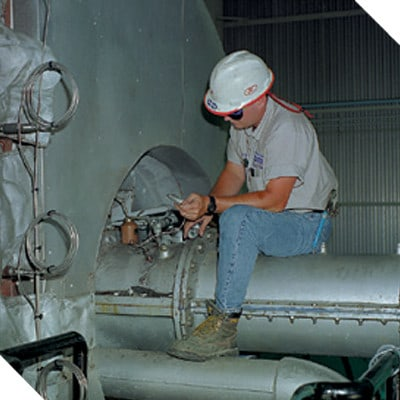 Petrotech technician working to repair a controller