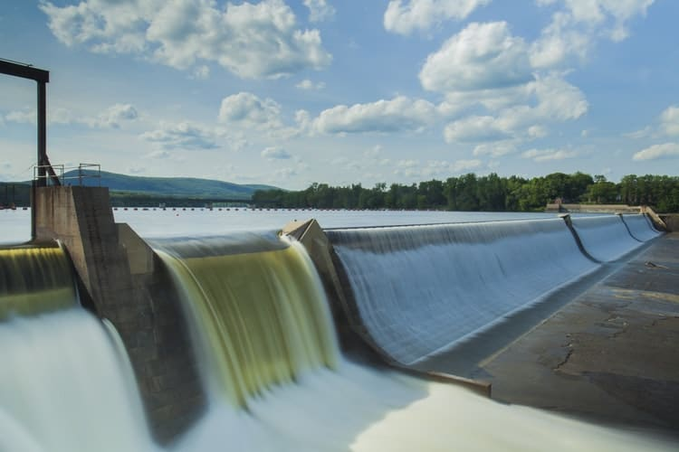 A large water dam representing that Petrotech, which is based in Houston, TX, won a contract to upgrade the control systems of 13 hydroelectric facilities