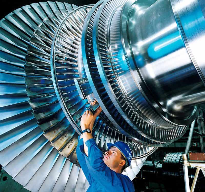 A man working on a steam turbine