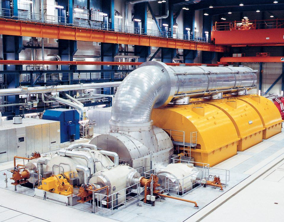 A yellow and silver turbine control system representing the use of governor in a steam turbine as explained by Petrotech, which has a location in New Orleans, LA